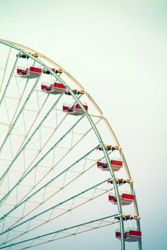 Up the ferris wheel where you and I once sat  looking up, looking down and laughing about our past.  loving the wind that brushes our face  shouting out loud and our heartbeats race.
