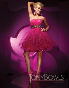 Strapless tulle over printed taffeta knee-length A-line dress, pleated bust line with hand-beaded Empire waistband, full skirt. Detachable straps included.