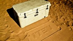 YETI logo in sand