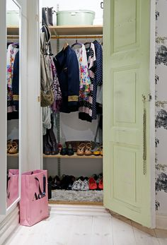 make-shift closet. Similar to my closet. Do a lot with a little space.