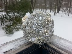 A silver and ivory pearl brooch bouquet created for a 2015 bride. Please contact me at claybouquetshop at gmail to discuss your custom wedding bouquet! #ClayBouquetShop #Bling #Wedding #Bouquet