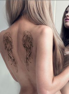 This but in a smaller size on the back of my neck with a meaningful word into the angel wings