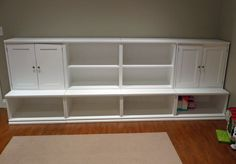 Would love to do something like this for our living room.  Put the tv on top, and put the boxes in the cubbies.  Movies and video games in the cabinets.  make the bottom pull-out drawers