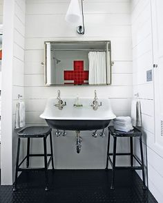 vintage stools are a nice way to get more surface area around a wall-mount or pedestal sink. Also love red cross in tile and vintage sink.