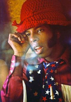 funny kitsch fashion photo , now thats how to wear a knitted cloche hat , man woolly fun Sly Stone