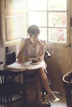 A girl having her break with coffee and cake