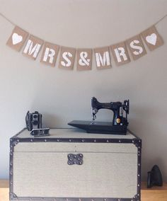 Personalised Vintage Wedding Bunting Banner Mrs & Mrs. Each hessian letter measures 6 x 4.2 and individually painted in cream by hand. The bunting is hung by natural jute which is threaded through a doubled edged top for extra strength. Each individual letter square is double stitched at each side for a professional finish. Overall length is 85 and each letter can be moved along the jute to make the bunting longer or shorter. This vintage rustic bunting would look fantastic in your wedding…