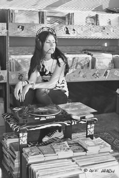 She plays her vinyl records singing songs on the eve of destruction