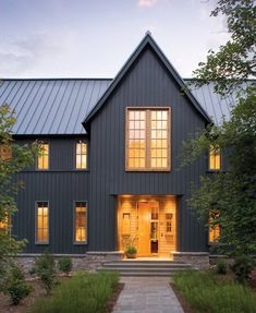 Grey House With Black Roof. Exterior house colors with black roof, charcoal grey houses with metal roof. Grey house with red door. Modern Farmhouse Exterior, Farmhouse Style, American Farmhouse, Farmhouse Design, Fresh Farmhouse, Farmhouse Front, Cottage Design, Farmhouse Plans, Farmhouse Decor
