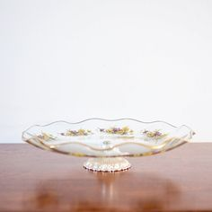 Beautiful dishes like this are perfect for storing and displaying jewellery and beautiful things.  Vintage English Yellow FLORAL CAKE STAND Glass by BessGeorgette, $25.00