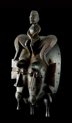 Africa | Senufo Kpeliye'e Double Mask | Wood; dark brown patina