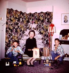 Mom and the twins, Christmas 1956. They got some fancy 2-way radios, and I think mom may just have a shiny new lamp in her future!