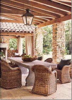 Belgian bluestone table; Sempre woven chairs by Thompson Hanson; French lantern; Eleanor Cummings