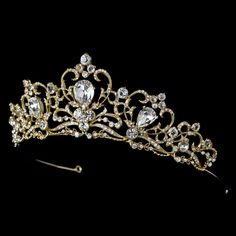 Simply stunning, this royal tiara features sparkling rhinestones and a silver plated curling design: the perfect addition to your classic or modern wedding. The ornamented portion of the piece ends wi