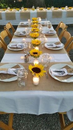 Country Rehersal Dinner Sunflowers and Burlap -Sunflowers (plate size is what they called them) were ordered from florist, stems were cut low and they were set in small glass sauce bowls with water.