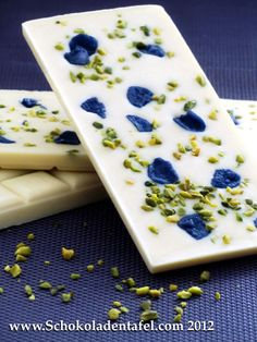 White chocolate with candied viola flowers and pistachios.
