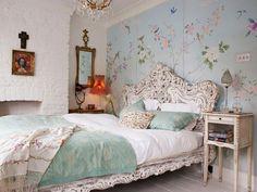 The ornate furniture, abundance of flowers and feminine details evoke a sense of whimsy and romance