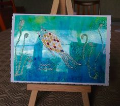 Lyn's work.  Denim, sailboat blue, stream, lettuce and citrus alcohol inks with peel off and Stickles.