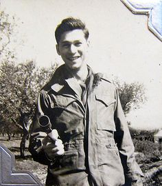 World War Two, United States Army Air Force (U.S.A.A.F.), 5th Photo Reconnaissance Group, 4th Photo Squadron, guarding with a Very pistol, Cpl. Donald Krasno (Photo Lab Tech) Italy, 1944 or 1945
