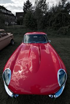 One of the cars which is abolutely a character.. I think this is one of the most famous long hoods of car history.  The wide angle lens really did its job here. - Unique Vintage Jaguar E Type.