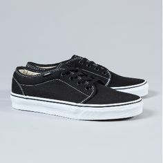 Vans  Women's Black And White 106 Vulcanised Trainers: An instant classic and an iconic style. Vans trainers are the go-to shoe for everyday cool. Vulcanised rubber sole, double stitched canvas upper, padded 'collar', minimal branding at the heel.