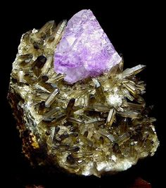 Purple Fluorite on a matrix of Smoky Quartz (Cubic and Trigonal crystal systems combination). Mental focus, great combination to eliminate mental distractions.  Photo from www.exceptionalminerals.com