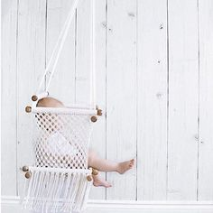 Gorgeous Adelisa & Co. handmade, macramé baby swing. Our macramé baby hammock swings are handmade in Nicaragua by talented artisans. With beautifully crafted wooden bars and cream coloured cotton, these Adelisa & Co. macramé baby swings are the perfect neutral baby item for your home. Whether it's for a playroom, nursery, or living room- this swing will fit beautifully with any type of décor. This baby and toddler swing can also be used outdoors on sunny days.