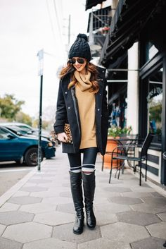 Mix up your oversized sweater and knee high boots by adding some casual knee high socks. The pop of leopard adds a touch of glam!