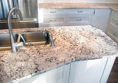 Alaska white granite is a stunning stone that looks just like it sounds. It combines stunning icy whites with browns and greys to create complex patterns that White Kitchen Counters, White Cabinets White Countertops, Kitchen Cabinets Decor, Kitchen Countertops, Cost Of Granite Countertops, Granite Paint, Updated Kitchen, New Kitchen, Kitchen Reno