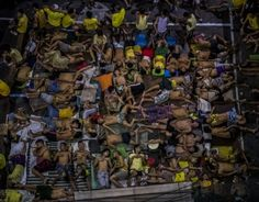The police say that by November, government forces had gone door to door to more than 3.57 million residences, and that more than 727,600 drug users and 56,500 pushers had surrendered, overcrowding jails and prisons. At Quezon City Jail in Manila, the situation is so bad that inmates take turns resting on any available space, like this basketball court. (10/19/2016)