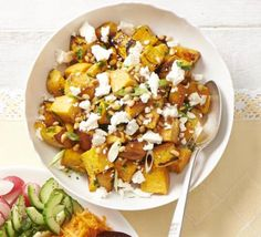 Swap heavy mayonnaise and spuds for roasted sweet potato, salty Greek cheese, fresh herbs and pine nuts