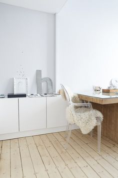 White cabinets and pine floors in Wiesbaden Apartment by Studio Oink | Remodelista
