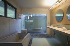 Concrete is one more material to consider for a modern bathtub. Since it can be poured and molded into any shape, the possibilities are endless.