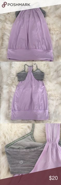 """Lululemon sports bra/tank Combo sports bra and loose fitting tank. This top is idea for low impact workouts and casual wear. Sports bra is connected at neckline and shoulder blades. 4"""" band at the bottom can rest near the waist or hips. Light purple / lavender solid color tank. Sports bra is purple & grey stripes. lululemon athletica Tops Tank Tops"""