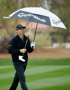 Ryan Palmer walks under an umbrella on the second hole during the second round of the Waste Management Phoenix Open at TPC Scottsdale on January 30, 2015 in Scottsdale, Arizona.