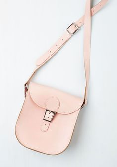 Tasteful in Transit Bag in Blush. From plane to train to automobile, you boast eye-catching zeal with this petal pink crossbody bag from hard-to-find UK brand Brit-Stitch - whose history began in 67 with a milkmans cash bag and continues through you! #pink #modcloth