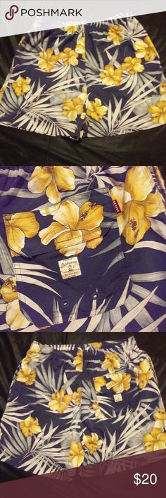 Vintage Tommy Bahama Bungalow Brand XL Trunks! These swim trunks are in great condition. Made by a trusted brand well known for quality products. They are a size XL and they are 17.75 inches from top to bottom. Color scheme is black and yellow floral. String is present. Netting is present. Tommy Bahama Swim Swim Trunks