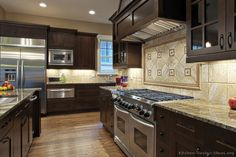 Kitchen of the Day: Professional appliances, shaker espresso cabinets, natural stone backsplash...    #20 in Traditional Dark Wood Kitchen Cabinets