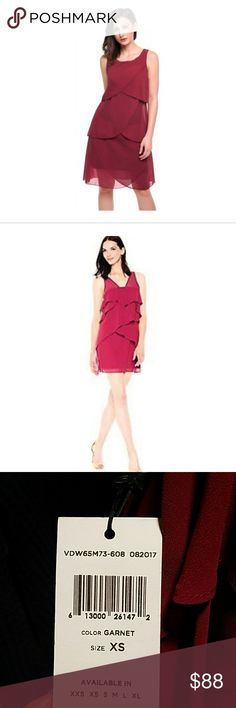 """BCBGMaxazria Sleveless Ruffled Dress in Garnet Cocktail dress of tiered ruffles in breezy chiffon V-neck V-back Sleeveless Easy-fit Pull-on style Lined About 34"""" from shoulder to hem Polyester textured chiffon Machine wash Imported. BCBGeneration. Size: XS.  Brand:BCBGeneration  Style:Prom & Dance, Cocktail & Party  Silhouette:Sleeveless  Size type:Regular  Size:XS  Material:Chiffon, Polyester BCBGMaxAzria Dresses Midi"""