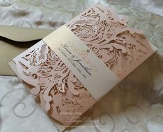 Elegant wedding invites, your wedding details carefully designed and printed in Australia and servicing internationally. These invitations are laser cut in blush pink and gold, metallic foil gold card or silver gates, digitally printed (not metallic colours), with RSVP cards, set of 50. They are delicate and elegant, romantic and modern. The invitations have a unique lace cut out, with rose swirls design on the front gates. The gates wrap the card with your details, when close, are approx…