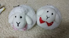 Little lamb dolls made by fluffy socks. Ac hanging on the phone.