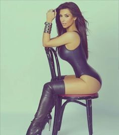 Kim in purple bathing suit, gold and thigh high beautiful black boots