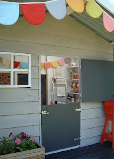 mousehouse: A mousehouse playhouse with a Dutch door, bunting, and chalkboard planned around a swatch of Orla Kiely fabric