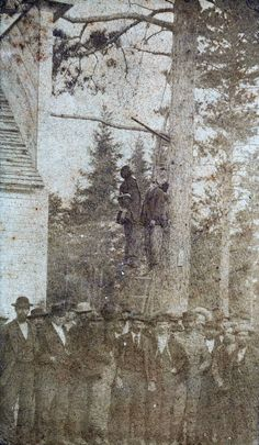 "The lynching of two ""half-breed"" Chippewa Indians in front of the Last Turn Saloon for the kidnap & murder of Helen McArthur. Brainerd Minnesota 1872 [1677x2882]"