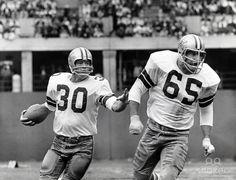 Dan Reeves runs behind guard John Wilbur in this 1968 game against the St. Louis Cardinals. Reeves suffered a season ending knee injury on this play.