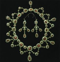 Ruby parure, Danish Crown Jewels. Look at the added hooks that go over the ear to support the weight of the earrings.