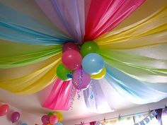 Plastic tablecloths draped to make and awesome (and cheap) party ceiling! Use school colors for a graduation party.