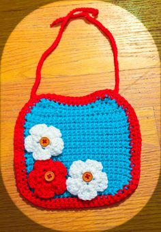 Crochet Red, White, and Turquoise Flowered Baby Bib