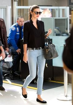Cute blouse outfit - skinny jeans, belt, flats, cute bag, simple black blouse, pulled back hair, and sunnies