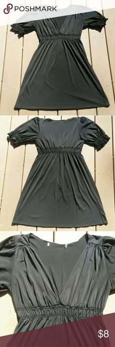 ☆MAKE AN OFFER☆ Black babydoll style dress with sexy, low v-neck chest, banding at waist and peasant style short sleeves. Hits around knees. Stretchy material ideal for summer nights or beach cover up. Super comfortable & flattering cut.  MISSING TAGS. Measurements available upon request.   ☆ Feel free to make an offer or bundle your likes for a private discount. ☆ Dresses Midi